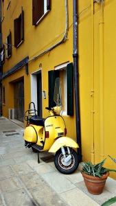 Iconic Italian yellow Scooter, Vespa near Venice.