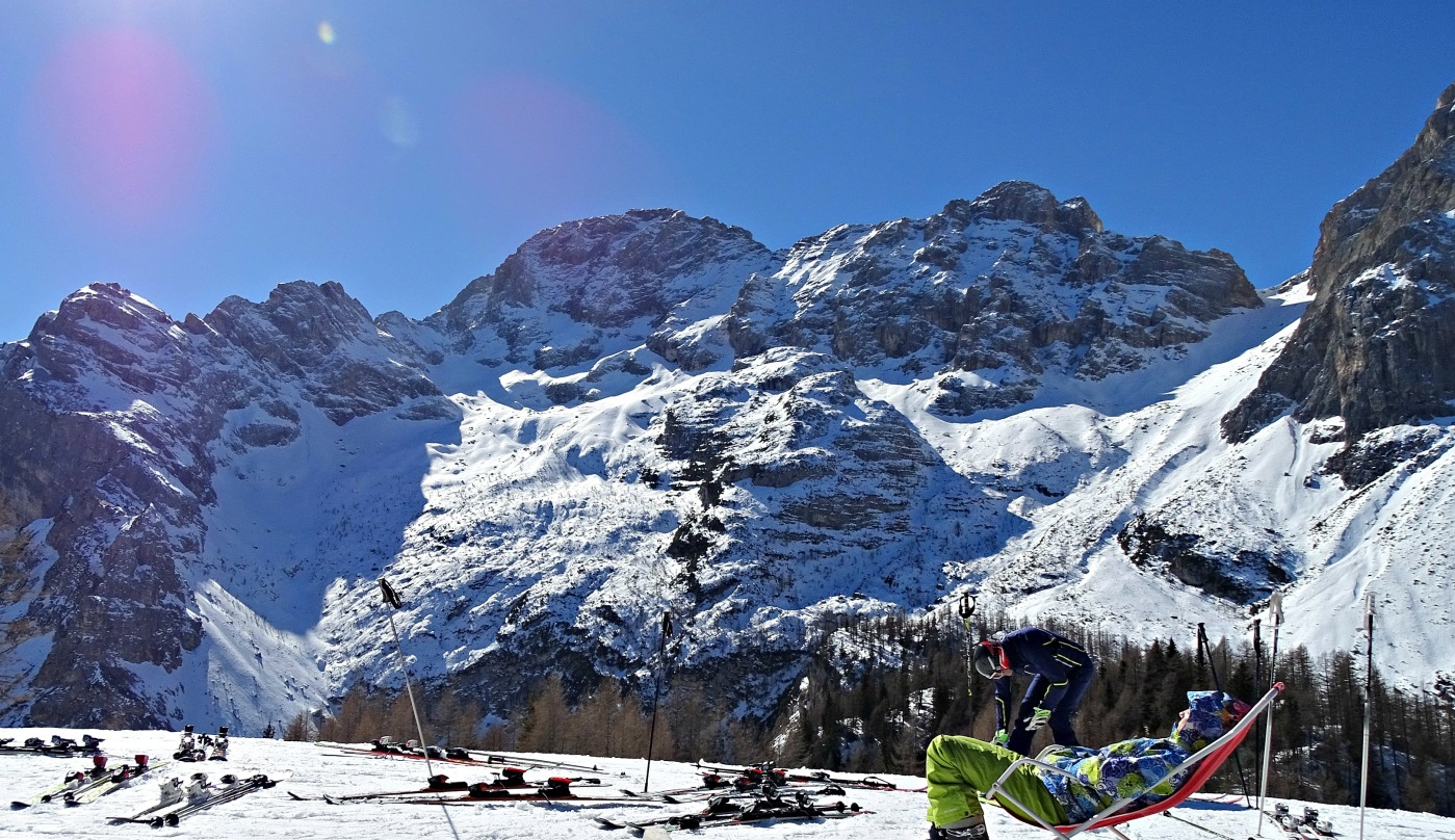 An exhausted skier enjoys his well earned break. Val di Zoldo, Dolomiti